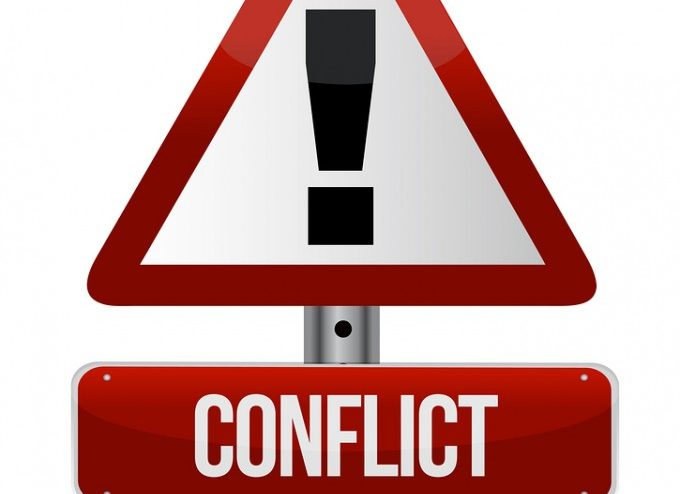 bigstock-Conflict-Warning-Sign-39489733_2e05e0504a37554f38323464431aac51