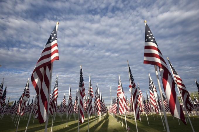 bigstock-Flags-With-Clouds-9047524_8c3ebc99482a59044ee66c441a54b430