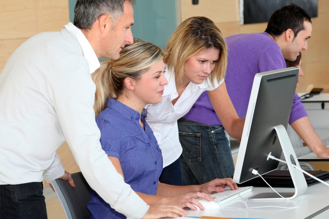 bigstock-Office-workers-on-business-tra-17001020_96543b669e08401dab669a9e64f00672