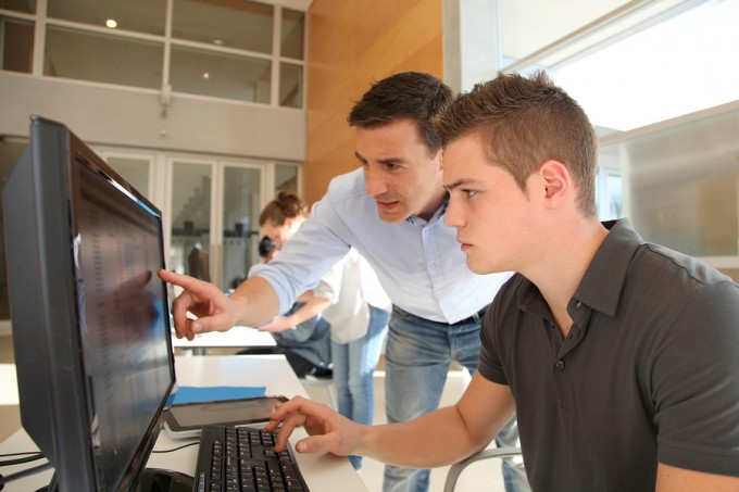 bigstock-Teacher-and-student-working-on-30690470_f1a30b4713f625321e00f1cf50280ea6