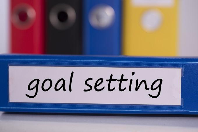 bigstock-The-word-goal-setting-on-blue--61217852_a64652a808349303c354c8392e8765f0