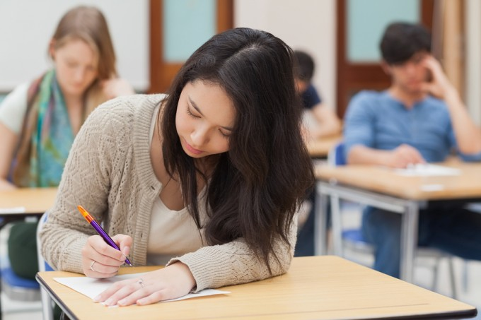 bigstock-Woman-doing-an-exam-in-exam-ha-38647918_8a5336696c480b6833b86530be9c9a46