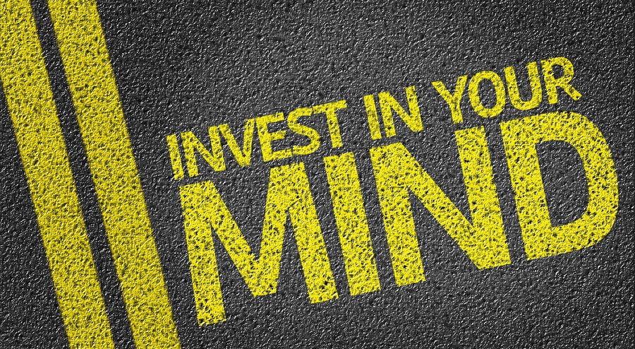 Invest in Your Mind written on the road