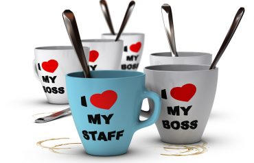Many mugs where it is written I love my staff and my boss symbol of staff relations and motivation in workplace.
