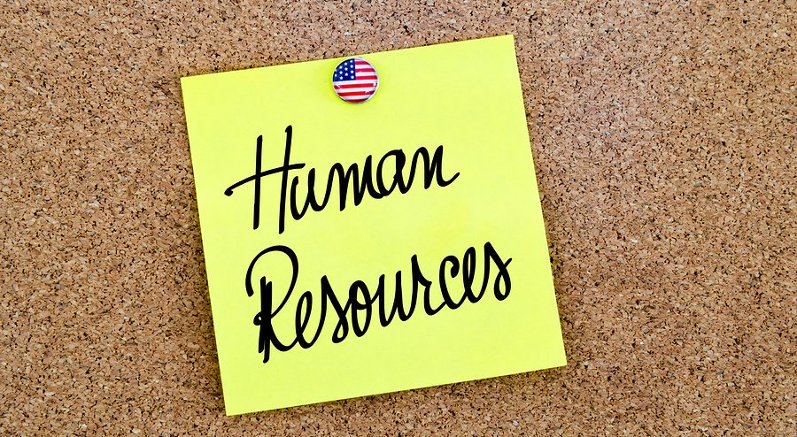 Written text Human Resources over yellow paper note pinned on cork board