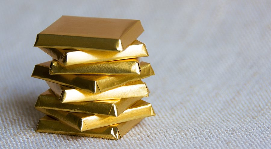 Chocolate bar squares wrapped in a golden paper