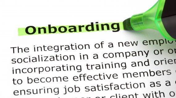 Dictionary definition of the word Onboarding highlighted with green marker pen.