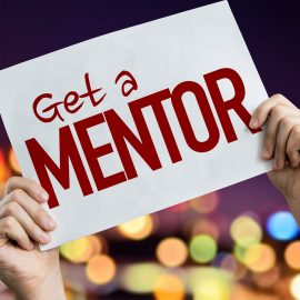 Get a Mentor placard with night lights on background
