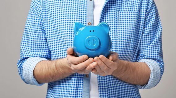 Man holding piggy bank, closeup
