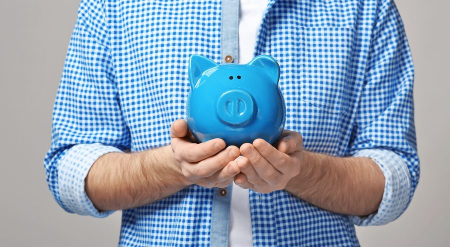 Man holding piggy bank, closeup